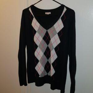 Black sweater with grey argyle print.